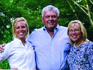 Casey Gary and Lorri Saunders family picture Bring Your Mojo golf tournament in memory of Gary Saunders