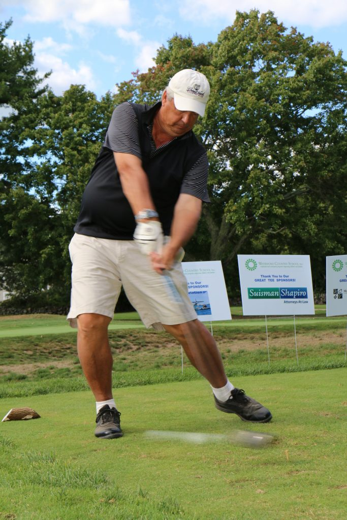 Bill Stanley from L and M Hospital takes a swing as one of the golfers for the Bring Your Mojo charity golf tournament to benefit waterford country school