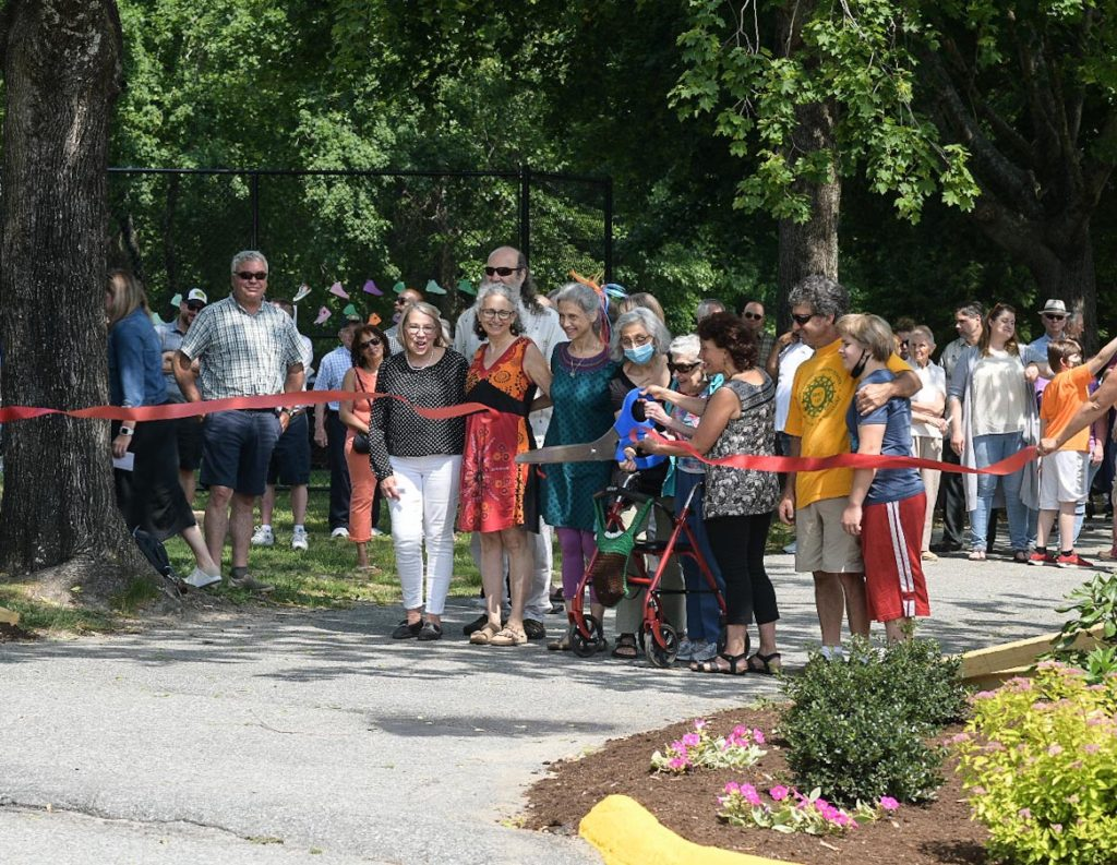 Schacht family members cut the ribbon dedicating the newly built Founders Park at Waterford Country School